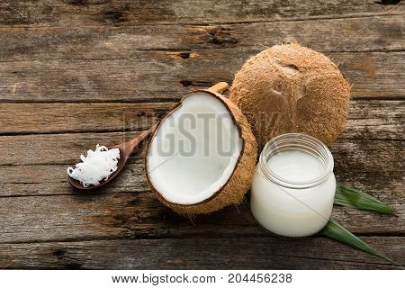 Coconut With Coconut Oil On Wooden Table Background. Good For Package Design Element