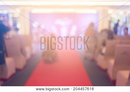 Blurred background of business people in conference hall or seminar room.