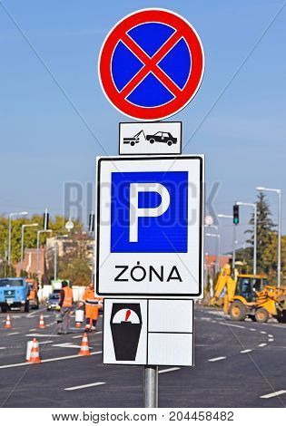 Parking zone and no stopping signs on the road