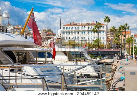 Cannes, ITALY - September 18, 2016: Super yachts in the Le Vieux Port of Cannes. Cannes yachting festival view in sunny day.