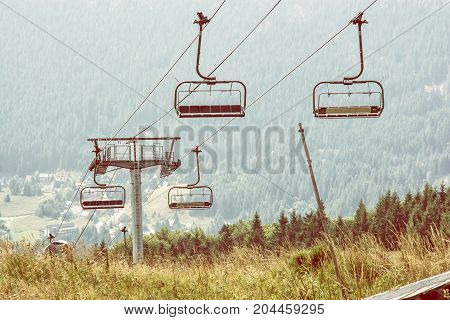 Cableway Donovaly Slovak republic. Tourism theme. Mountains scene. Photo filter.