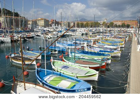 Nice, France - October 2012: Colorful fishing boats in harbor of Nice, France in October 2012