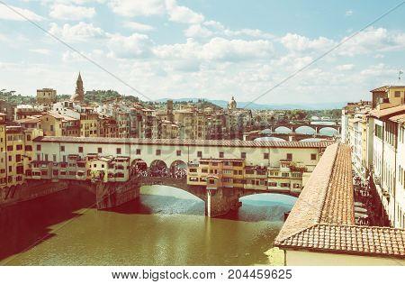 Ponte Vecchio bridge over the river Arno Florence Tuscany Italy. Travel destination. Photo filter.