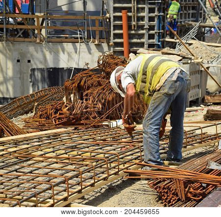 Construction worker at work at the construction site