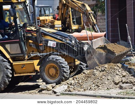 Excavators are working at the road construction