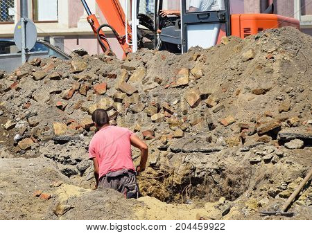 Man is working at the road construction