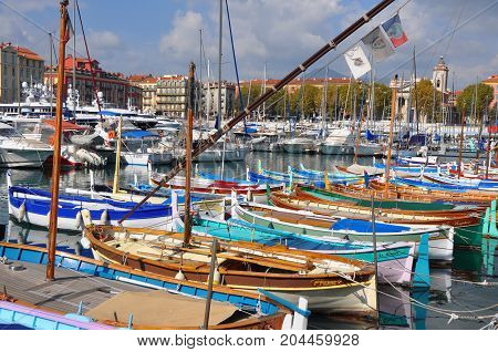 Nice, France - October 2012: colorful small wooden fishing boats in harbor of Nice, France in October 2012