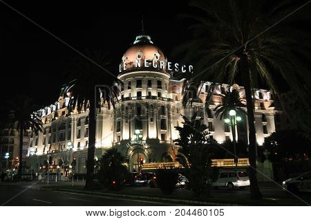 Nice, France - October 2012: Illuminated exterior of Hotel Negresco in Nice, France in October 2012
