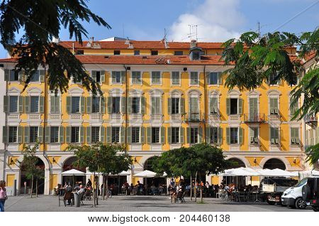 Nice, France - October 2012: People in and in fornt of Cafes on Place Garibaldi in Nice, France in October 2012