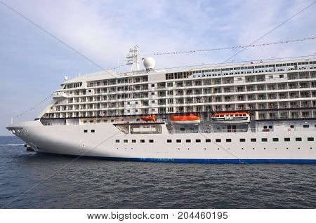 Monte Carlo, Monaco - October 2012: Huge vessel in harbor of Monte Carlo in October 2012, with people onboard
