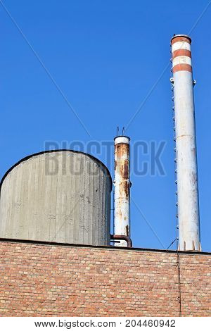 High smoke stacks of the factory in the city