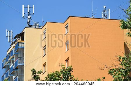 New apartment building with antennas on the top