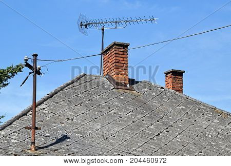 House roof with television antennas on it