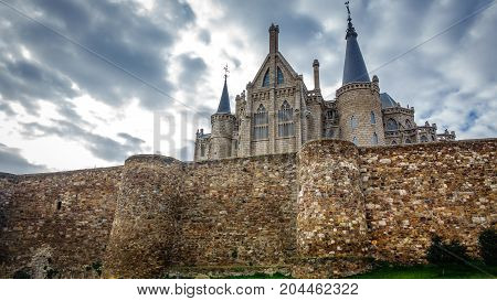 Wide angle view of Episcopal Palace and wall in Astorga, Spain