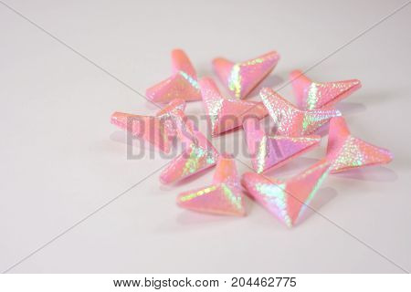 Pink paper hearts for Valentine's Day at white table for background or texture.