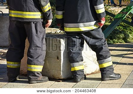 Firefighters are waiting outdoor in work suit