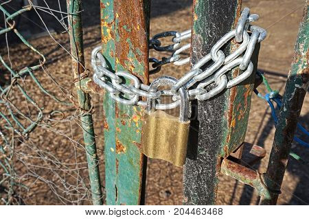 Closed metal door with padlock and chain