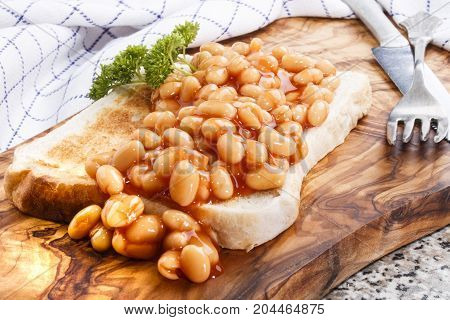 warm baked beans with tomato sauce served on toast