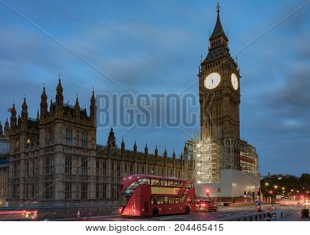 Double decker bus on westminster bridge, Big Ben and Palace of Westminster in the morning, London, England.