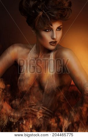 Creative photo of sexy adult brunette in bandage with fire in studio