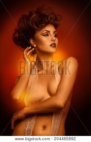 Fashion brunette looking away with bandage in studio