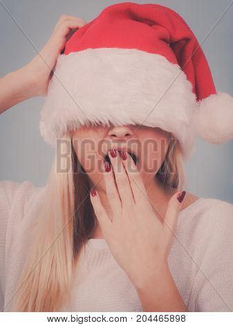 Yawning Woman Santa Claus Covers Her Eyes