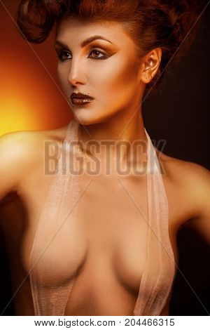 Sexual adult brunette looking away with bandage in studio