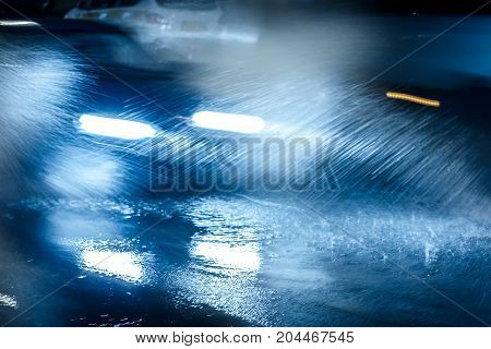 Cars Driving On Flooded Road And Spraying Rainwater Around