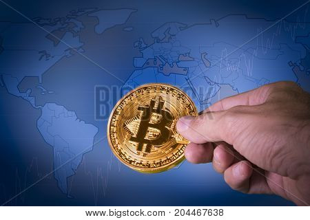 Financial growth concept with golden Bitcoins lon a world map. New virtual money