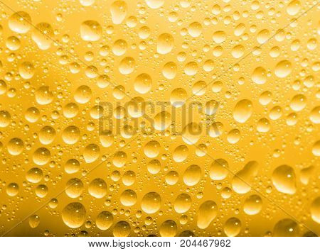 water drops on a gold background. macro