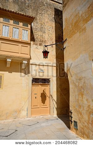 Traditional Maltese buildings along Magazines Street in the old town Mdina Malta Europe.