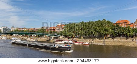 BREMEN, GERMANY - AUGUST 23, 2017: Panorama of a freifgt boat on the river Weser in Bremen Germany