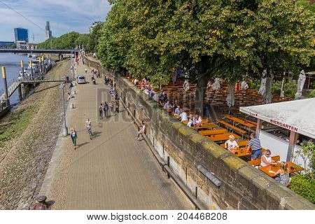 BREMEN, GERMANY - AUGUST 23, 2017: Outside cafe along the river Weser in Bremen Germany