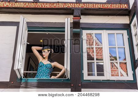 BREMEN, GERMANY - AUGUST 23, 2017: Mannequin in a window in the Schnoor district of Bremen Germany