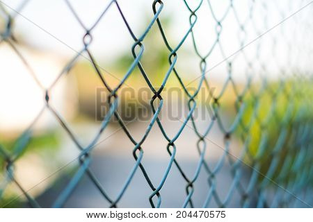 Blue welded wire mesh fence for vintage background or texture.