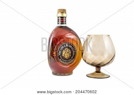 Ternopil Ukraine - August 26 2017: Brandy Vecchia Romagna. Made in Italy. Brandy aged in Oak Barrels. Bottle of brandy with glass isolated on white.