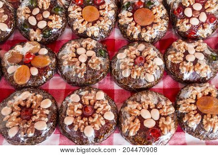 sweet brown cakes with nuts packed in transparent plastic