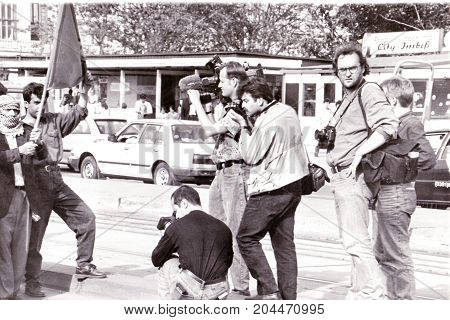 MAGDEBURG, GERMANY - ca. 1994: Journalists filming and photographing in Magdeburg a demonstration of sympathizers of the Kurdistan Workers' Party