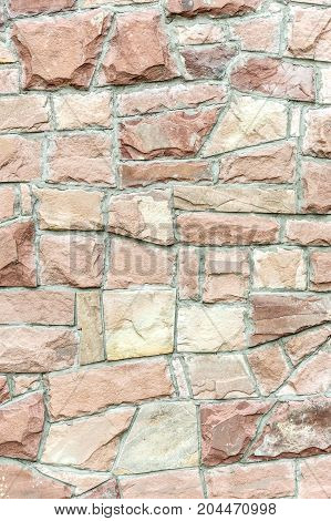 Stone wall as natural abstract background .