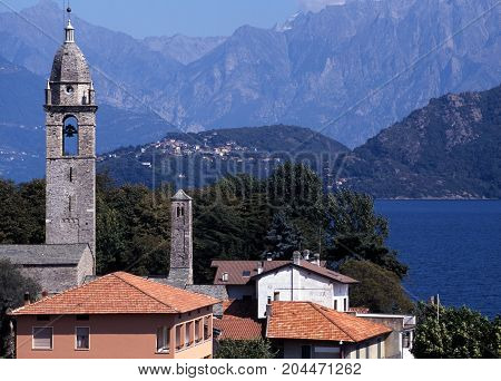 Bell tower and town rooftops Menaggio Lake Como to rear Lombardy Italy Europe
