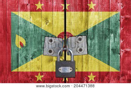 Grenada flag on door with padlock close