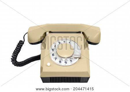 Old rotary phone against white isolated background
