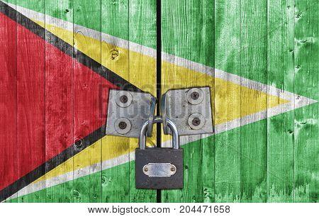Guyana flag on door with padlock close