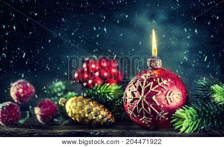 Christmas Candle. Christmas Burning Candle With Christmas Decorations In Snowy Atmosphere