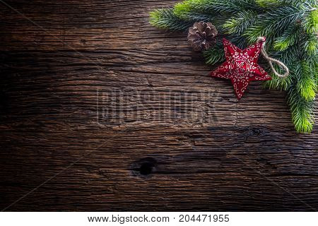 Christmas. Christmas Fir Tree With Star And  Pine Cone On Rustic Wooden Table