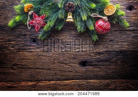 Christmas. Christmas Decoration Fir Tree With Star Jingle Bell And  Pine Cone On Rustic Wooden Table