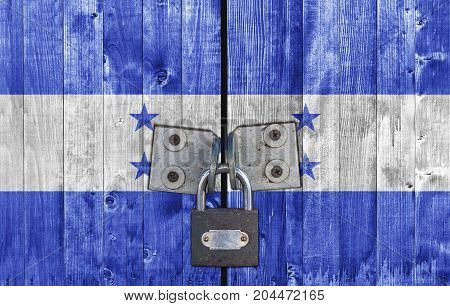 Honduras flag on door with padlock close