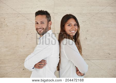 Business People With Crossed Arms Leaning Against Each Other Back