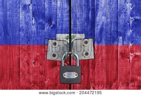 Haiti flag on door with padlock close