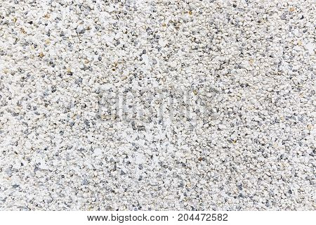 a gray grainy cement wall abstract background